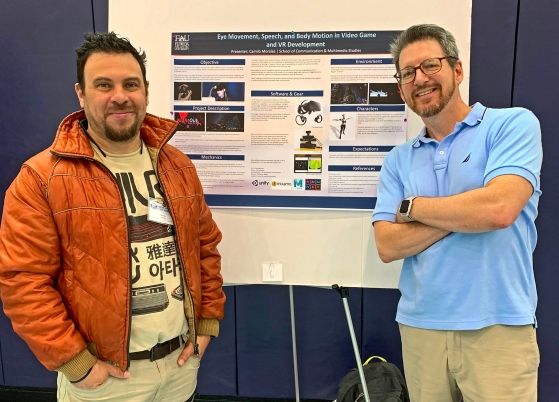 Topher Maraffi with MFA student Camilo Morales at the FAU Grad Research Day 2019.