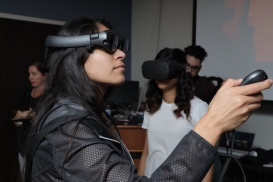 MTEn MFA students Ledis Molina and Monisha Selvaraj testing their projects on the Magic Leap and Oculus Quest headsets at Research Encounter 2020.