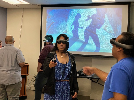 MTEn MFA students Ledis Molina and Andres Venton testing our research projects in the Magic Leap headsets. Brandon Martinez and Alberto Alvarez shoing their Homebound project on the projector at research Encounter 2020.
